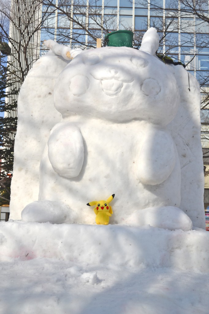 Pikachu (and Pikachu) get some sun. Several similar character parings could be found in the park.